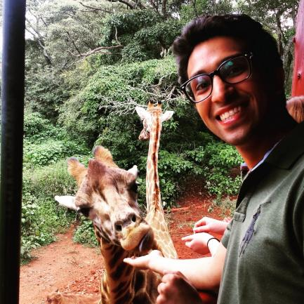 Student posing with giraffes at the Giraffe Center in Nairobi