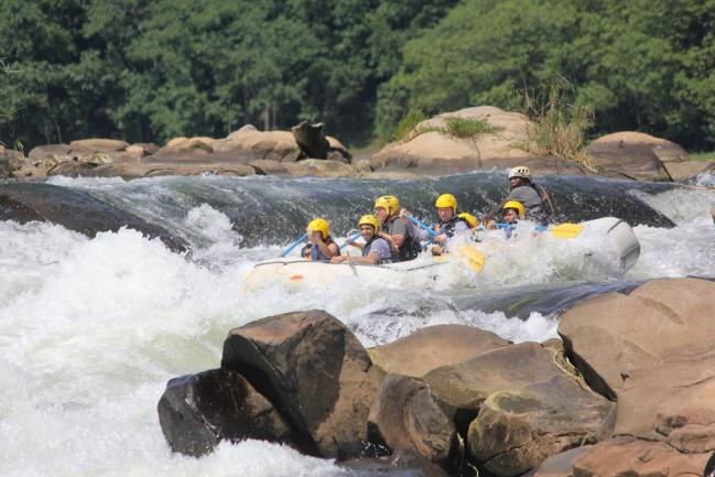 A group white water rafting in the Nile