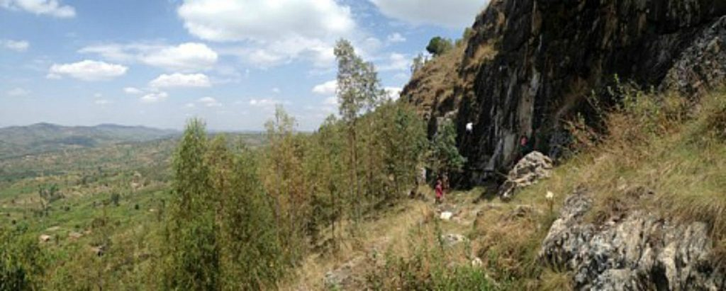 Jimmy rock climbing with friends outside the city in Rwanda
